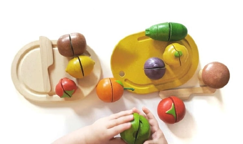 toddler playing with velcro food toy set