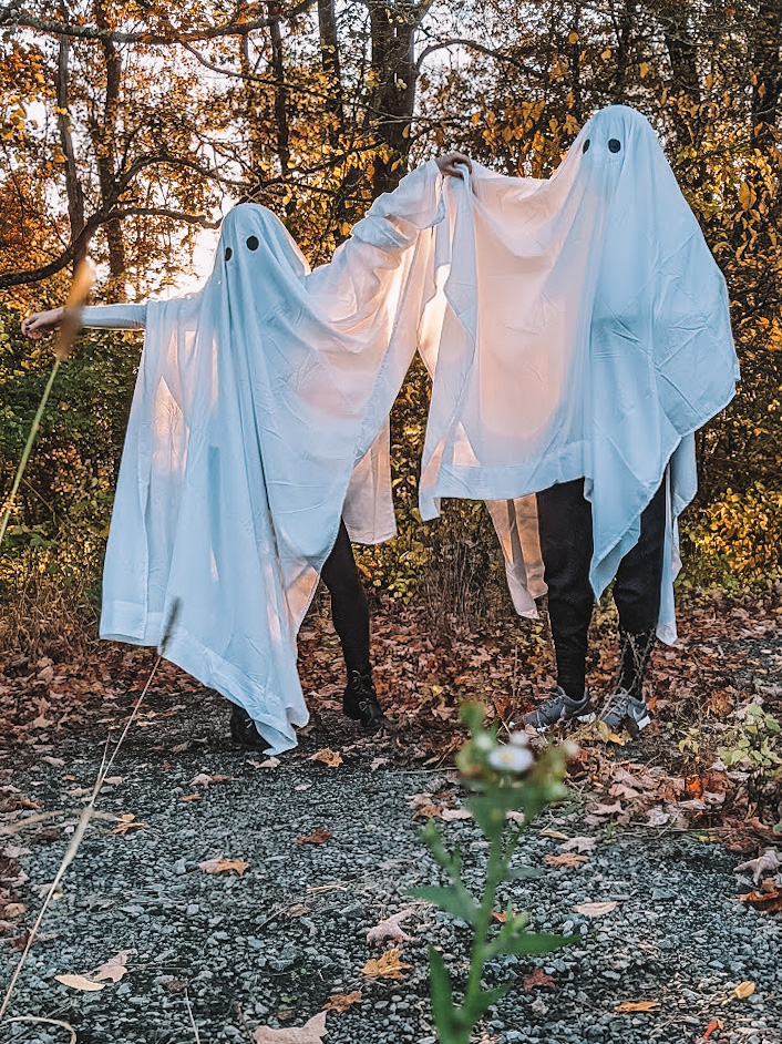 Fashion blogger Kathleen Harper and her husband Antonio Owens dressed as ghosts for a Halloween photo shoot.