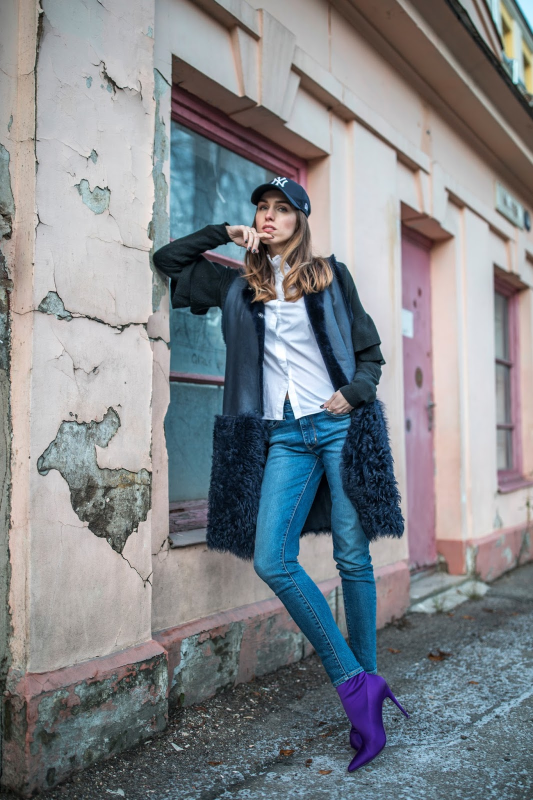 shearling vest jeans white shirt sock boots winter outfit