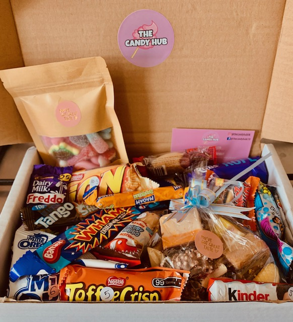 Cardboard box full of sweets, chocolate and fudge in wrappers