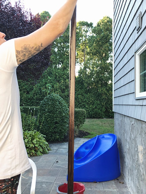 staining wooden pole