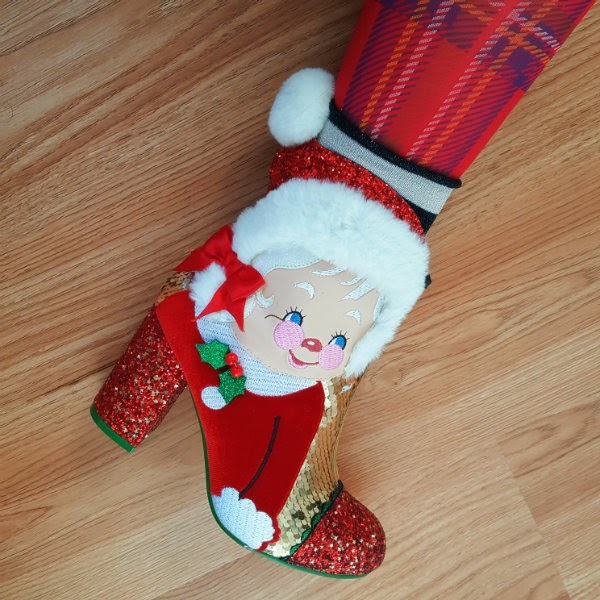 wearing tartan tights, glitter socks and Mrs Claus ankle boot