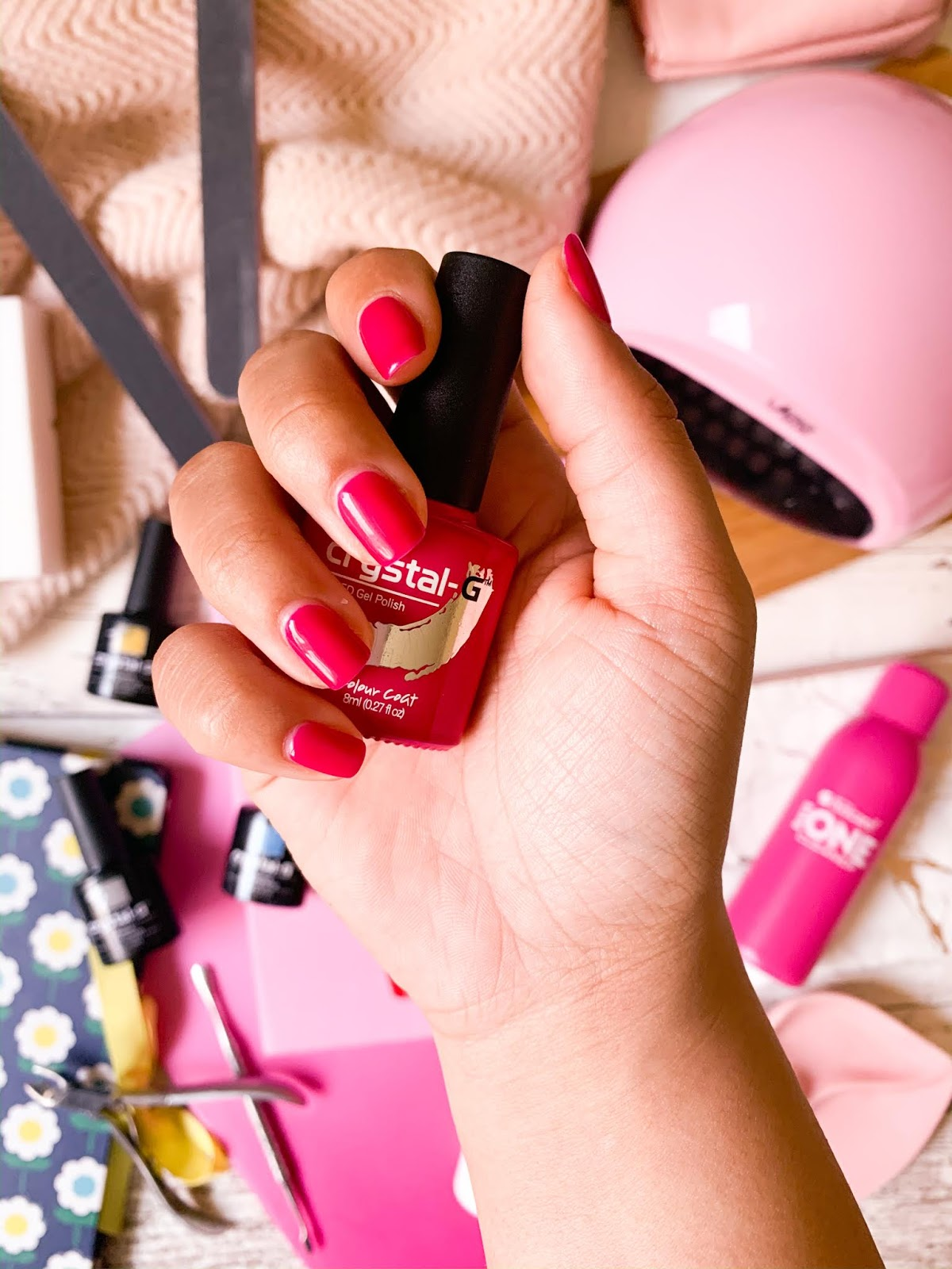 Flatlay of pink nails