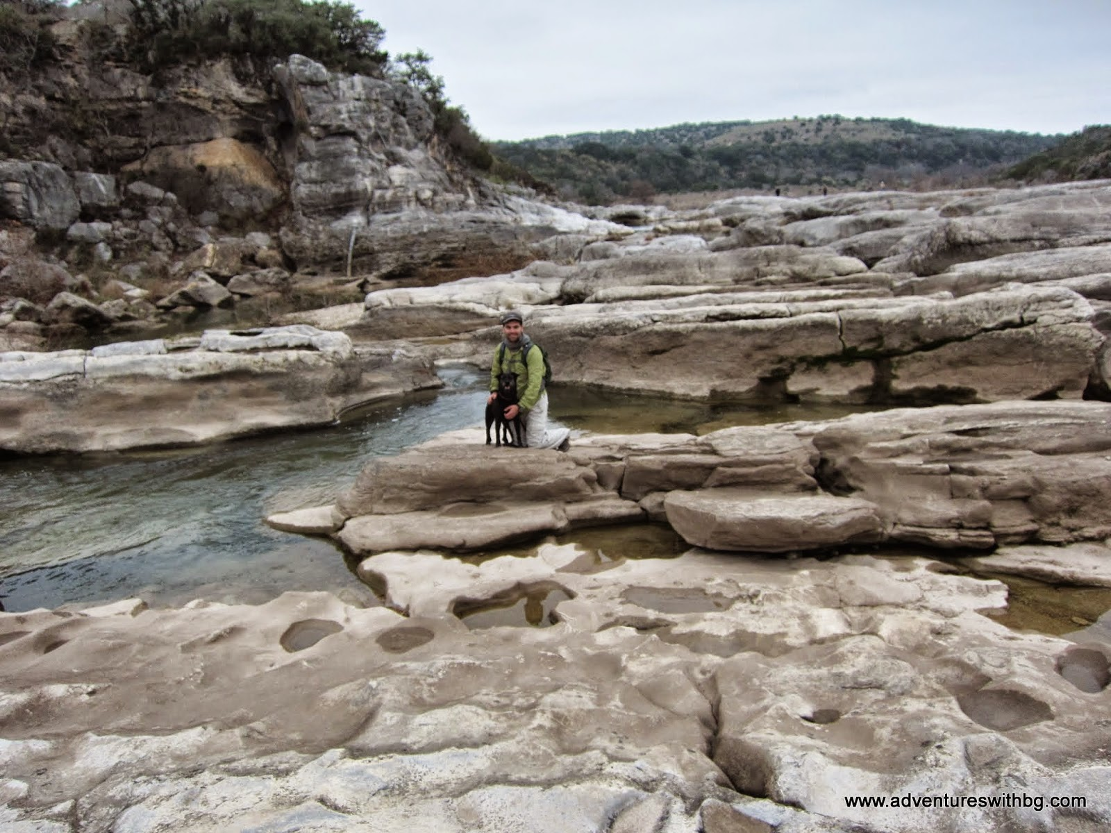 The water of the Pedernales River is quick flowing through all the rocks
