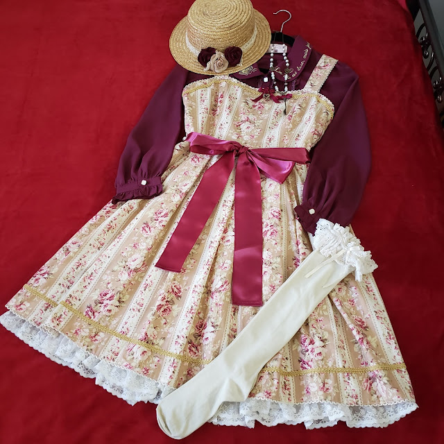 Second Coordinate, same dress with burgundy blouse, straw boater hat and matching flowers with ivory lace topped socks