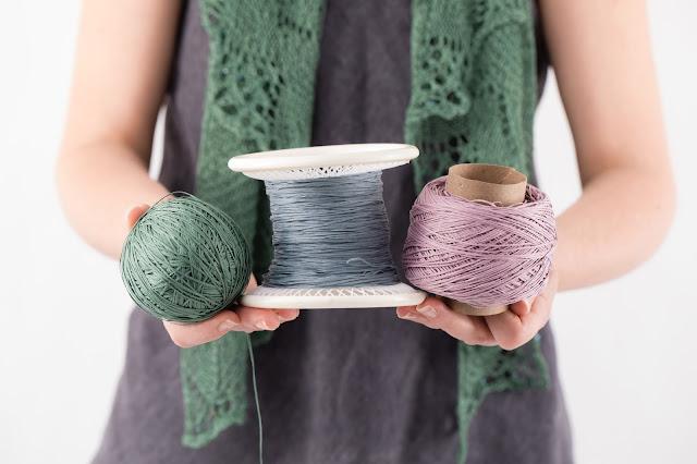 Woman holding slippery yarn wound three ways