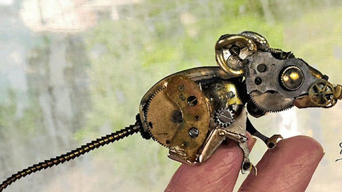 Intricate steampunk sculpture of recycled old parts watch ~ craft art ideas