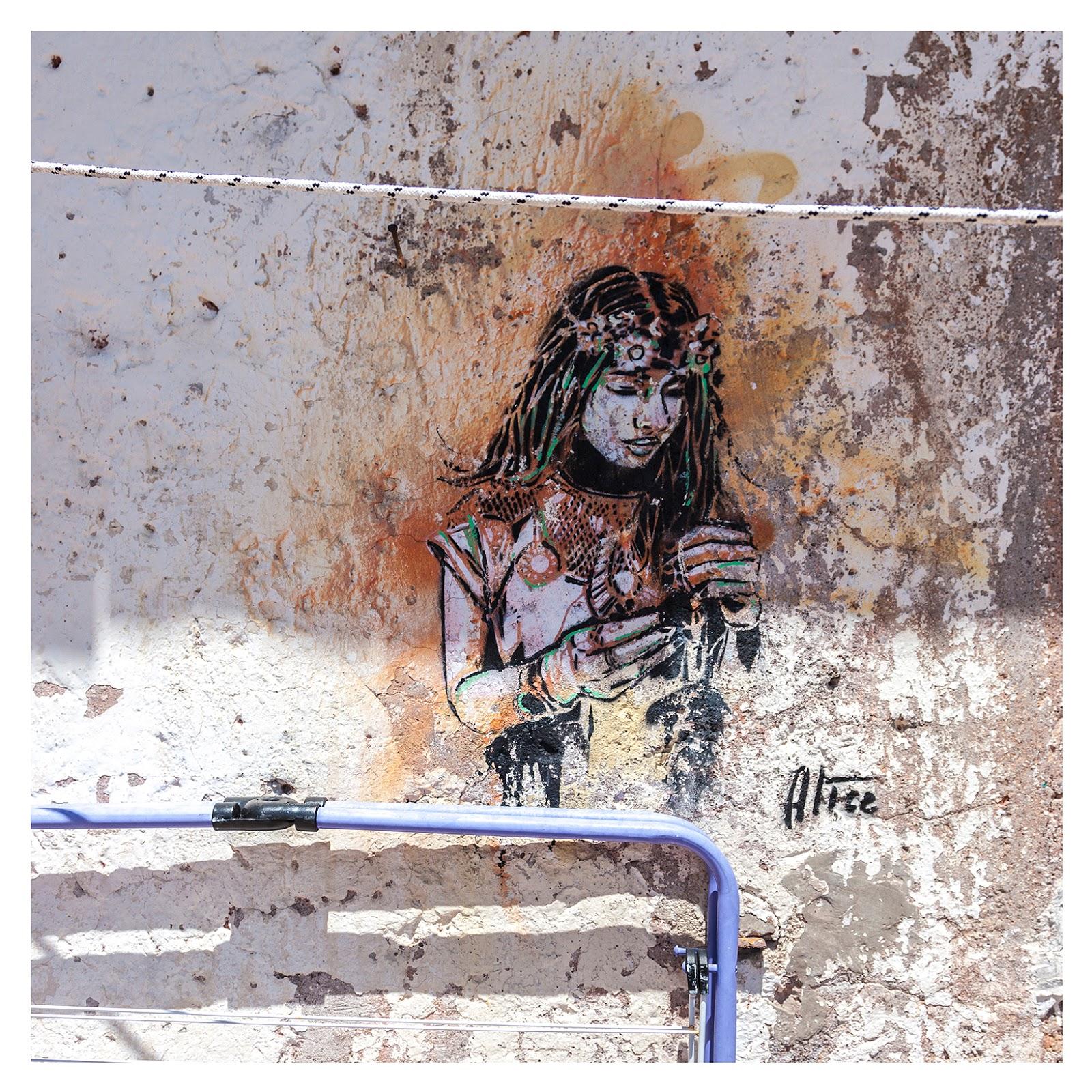 Stencil work in Rome by artist Alice Pasquini