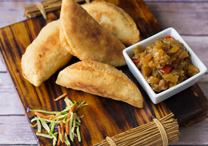 Fried aloo pies with a dipping sauce