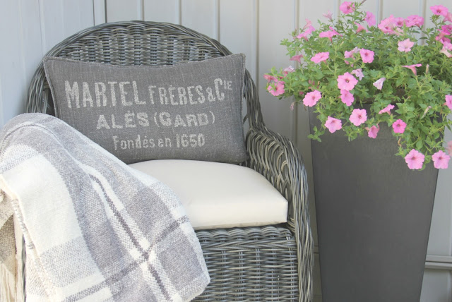 Gorgeous wicker Davies chair (Decor Market) on front porch - Hello Lovely Studio