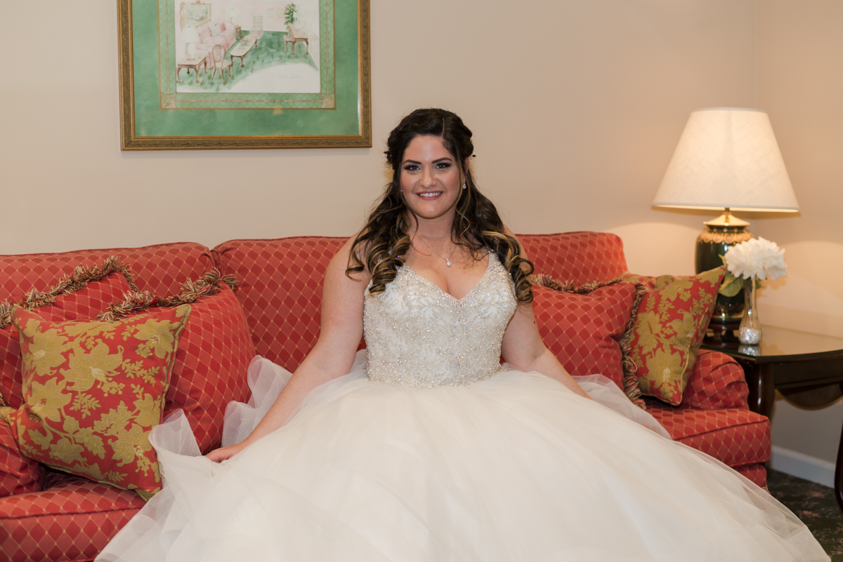 A lovely Bride beautifully adorned with an awesome wedding dress