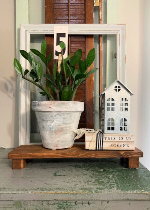 How to make risers for home decor - use wood risers to add levels to a home decor vignette