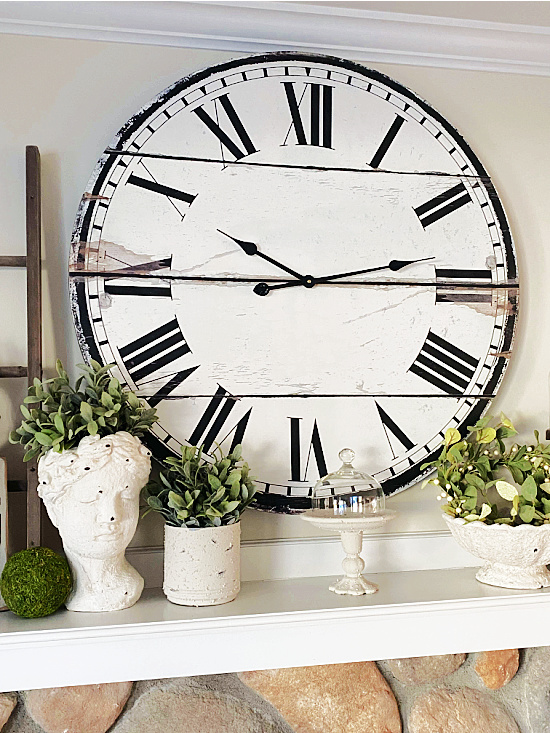 clock and mantel with cement items