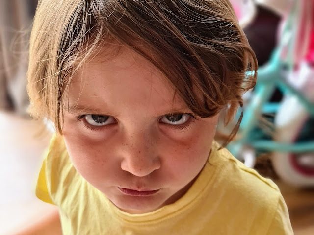 Image of a preschool age girl looking angry.