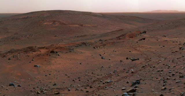 The surface of Mars is red due to the presence of iron oxides in the soil.
