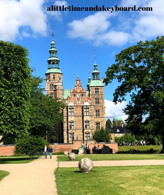 Admiring the Renaissance castle Rosenborg Slot in Copenhagen, Denmark.