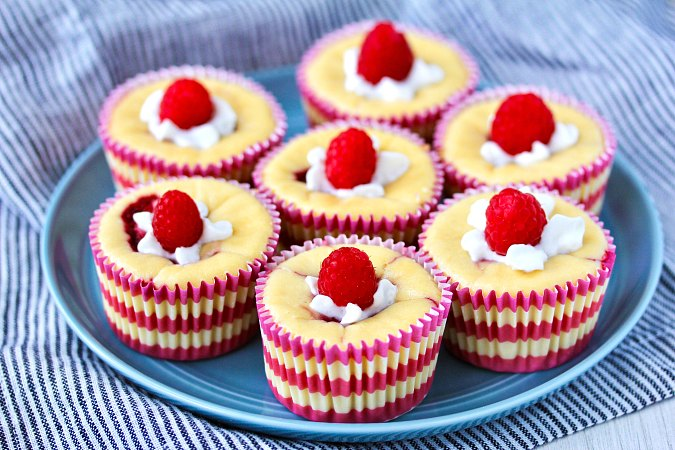 mini raspberry cheesecakes with whipped cream