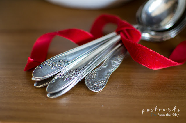 vintage silver spoons with red velvet ribbon