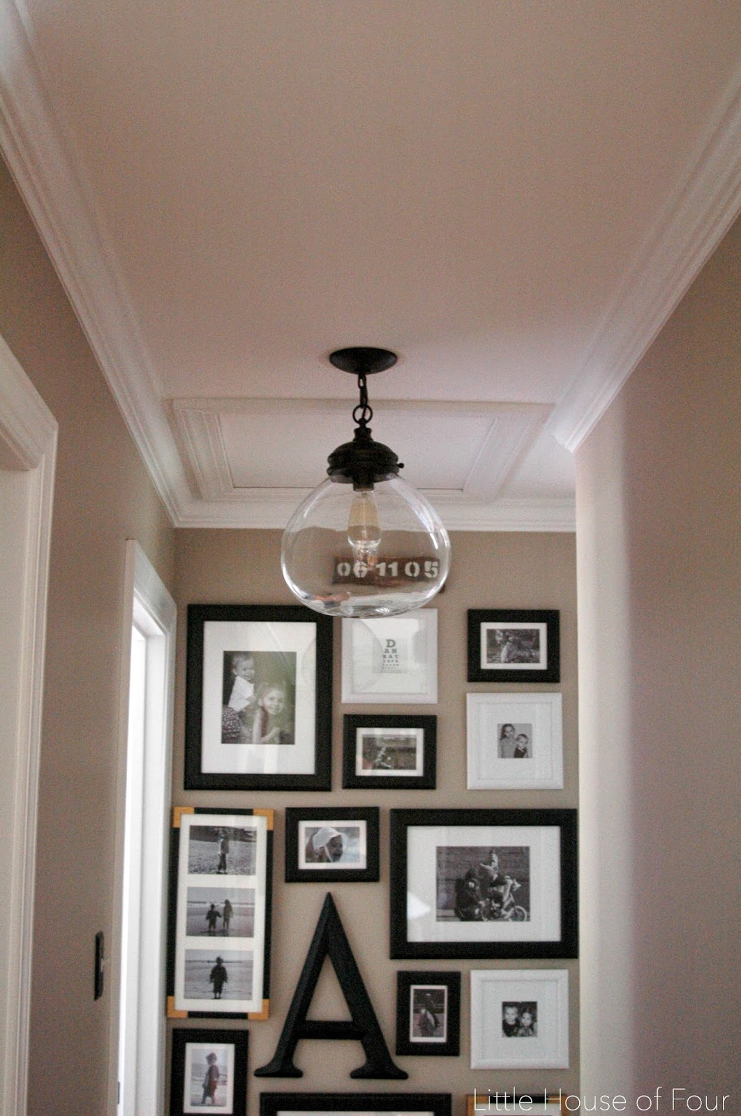 Allen+Roth clear glass globe pendant hung in hallway