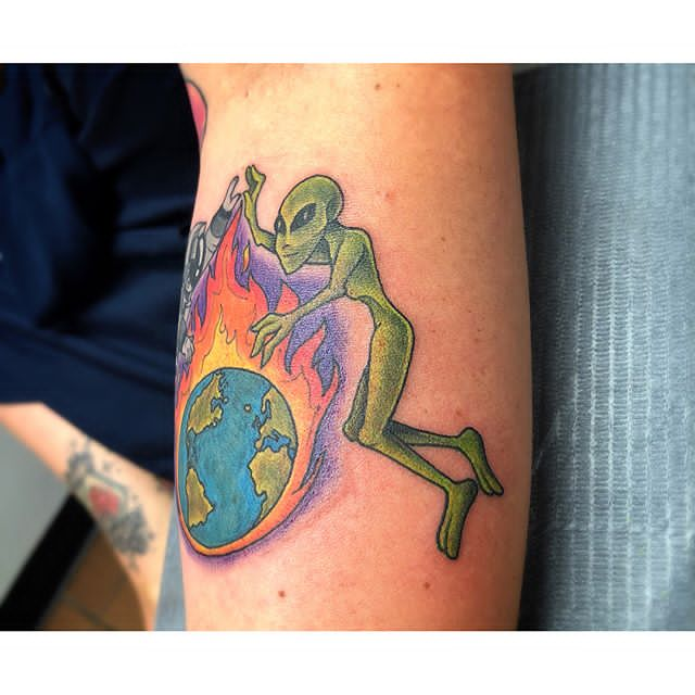 alien and earth tattoo