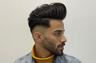 A guy with perfect pampadour hairstyle.