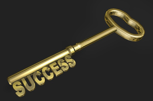 Gold key with the word 'success' making up the key teeth