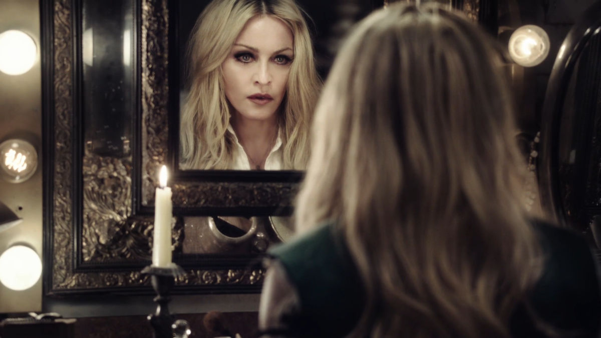 Madonna staring into the mirror for her Ghosttown video