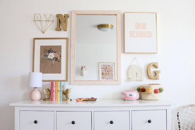 Beautiful boho gallery wall over a bright white dresser