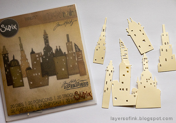 Layers of ink - Embossed Cityscape Tutorial by Anna-Karin Evaldsson, die cut buildings with the Tim Holtz Sizzix Metropolis set.