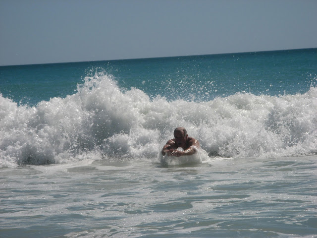 man body surfing in the ocean