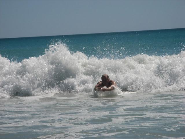 man body surfing in the ocean