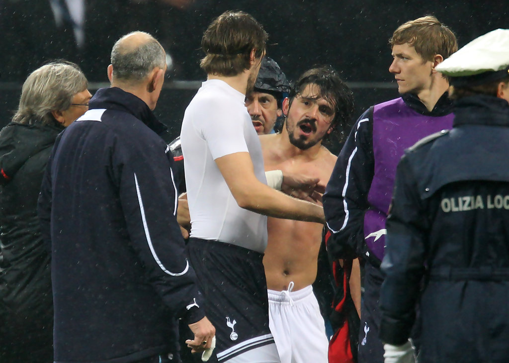 Tottenham Hotspur First Team Coach Joe Jordan and Gennaro Gattuso of AC Milan clash at the end of the UEFA Champions League round of 16 first leg match between AC Milan and Tottenham Hotspur at Stadio Giuseppe Meazza on February 15, 2011 in Milan, Italy