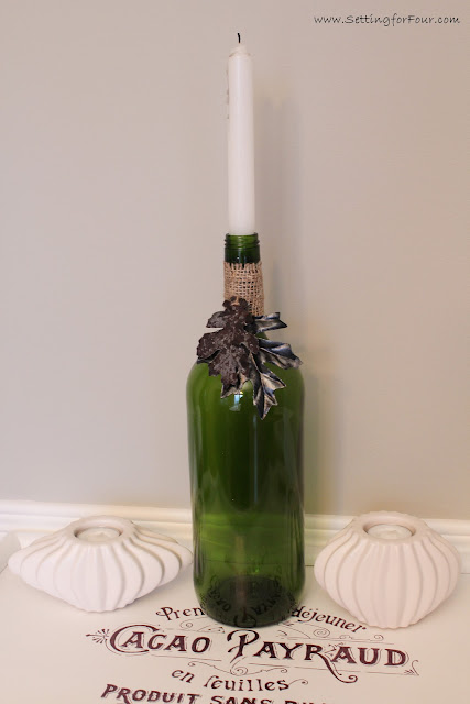 Fall Home Decor Idea: DIY Wine Bottle Candle Holder with painted leaves.