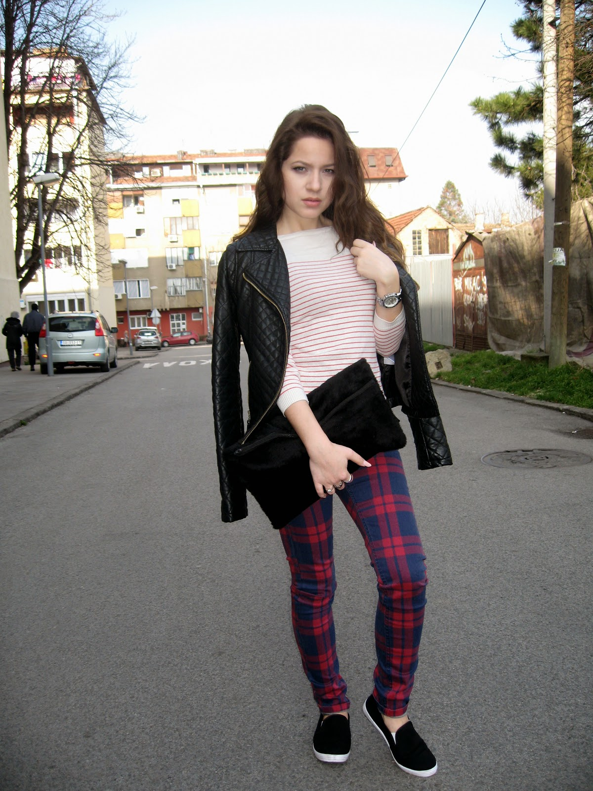 outfit, black faux fur clutch bag, plaid jeans, red striped top, black faux leather jacket, black slip ons