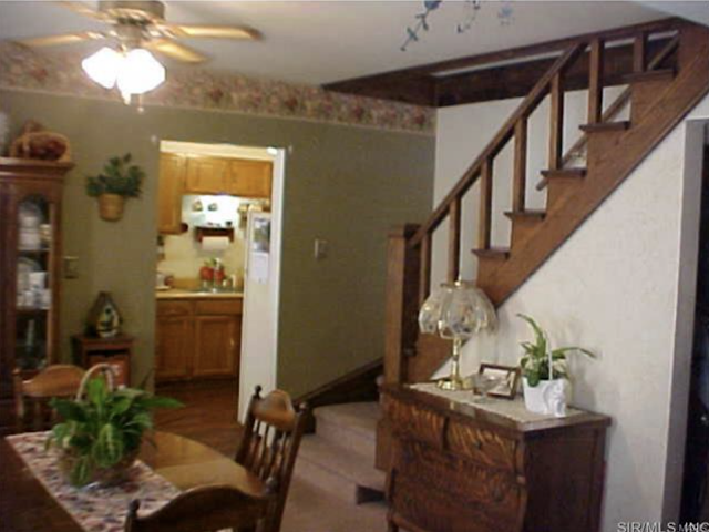 color interior photo of dining room and staircase Sears Vallonia 1316 W Main St Grafton IL