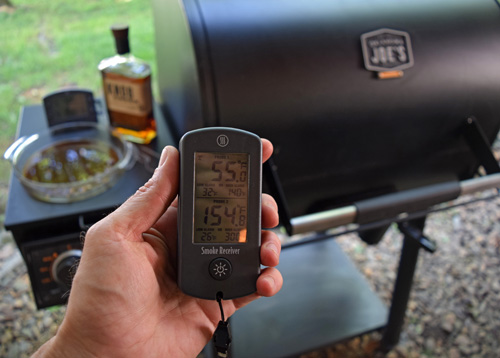 Using the Theromworks® Smoke remote probe thermometer to monitor temps from afar.