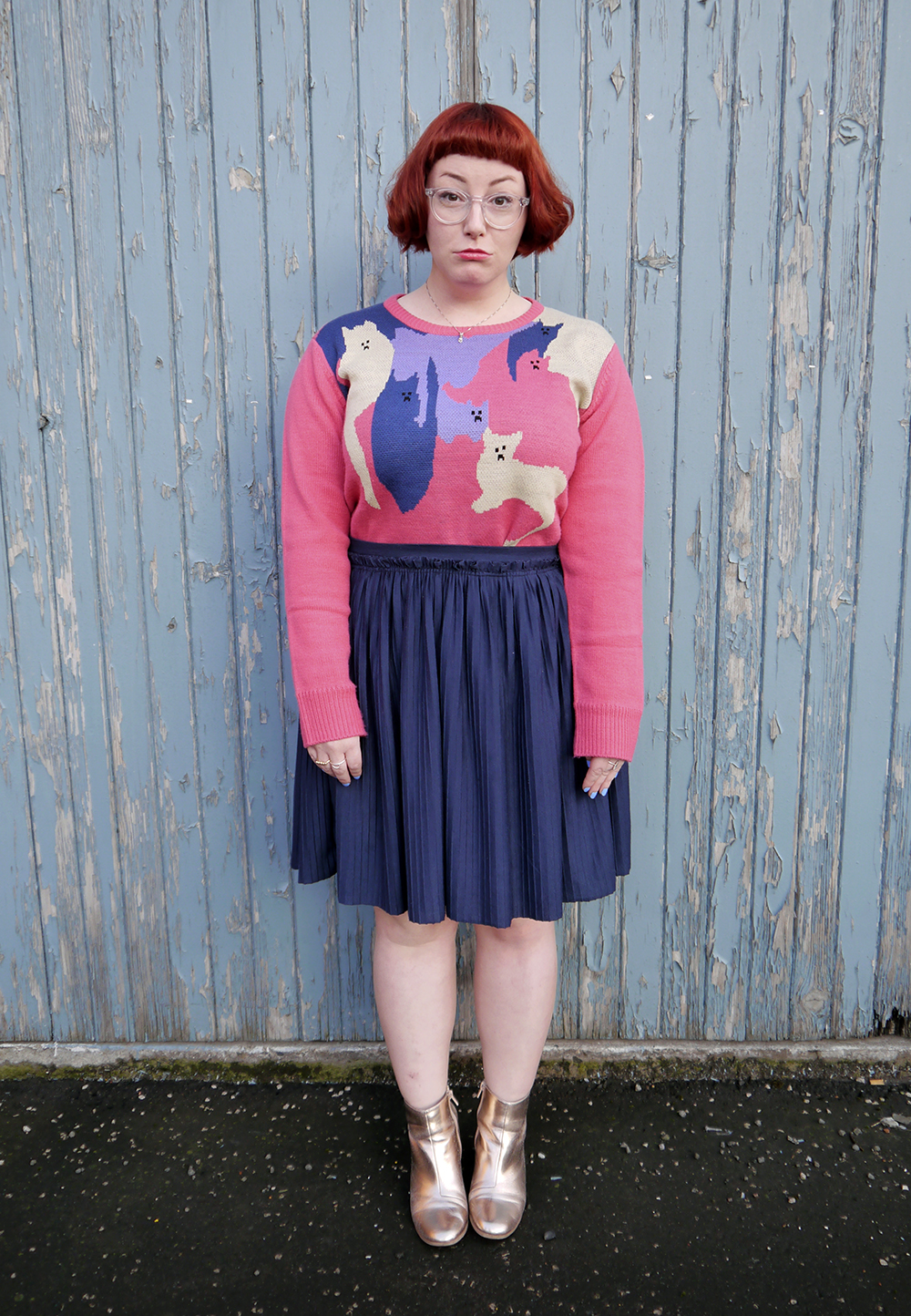 Styled by Helen, Scottish blogger, Dundee blogger, Scottish fashion blogger, quirky style, Scottish street style, cute style, cat clothing, dressing to a theme, cat themed clothing, cat jumper, colourful outfit, colourful street style, La La Land, colourful cat jumper, pink jumper, pink and blue outfit, red head, ginger bob, clear glasses, Iolla glasses, cat necklace, silver cat necklace, gold boots, cat pose, cute cat outfit, Wardrobe Conversations, silly face