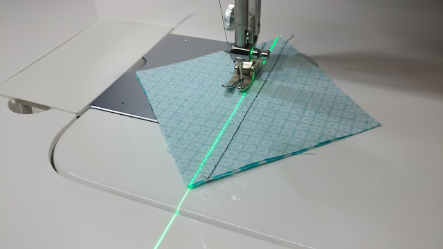 Using a sewing machine laser to sew half square triangles