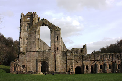 Photo showing one of many entry points to the abbey, over grass