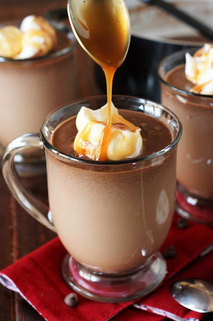 Drizzling Caramel On a Mug of Salted Caramel Hot Chocolate Image
