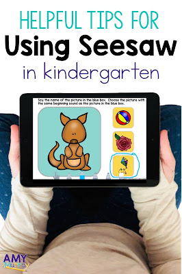 text: helpful tips for using seesaw in kindergarten Photo: kid hands holding an iPad
