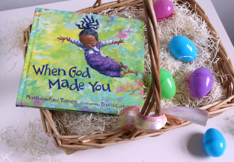 an Easter basket with a children's book with a little black girl on it