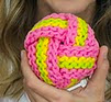 http://www.ravelry.com/patterns/library/knit-ball-scrubbie-and-youtube-video