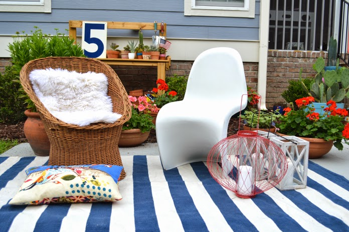 using indoor furniture to create seating area outside