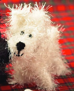 http://www.deramores.com/media/deramores/pdf/knitted-dogs-and-puppies.pdf