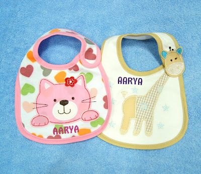 2 animal Bibs with name