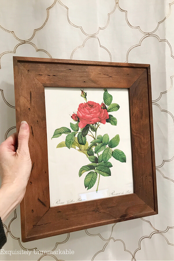 Red rose print framed in the bathroom