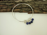 https://folksy.com/items/7115426-Sterling-Silver-and-Lapis-Lazuli-Charm-Bangle