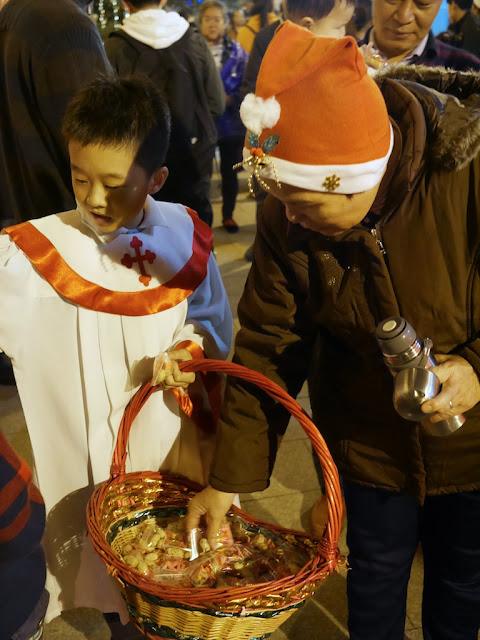 boy handing out candies