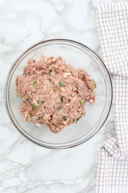 Ground pork patty mixture in a bowl